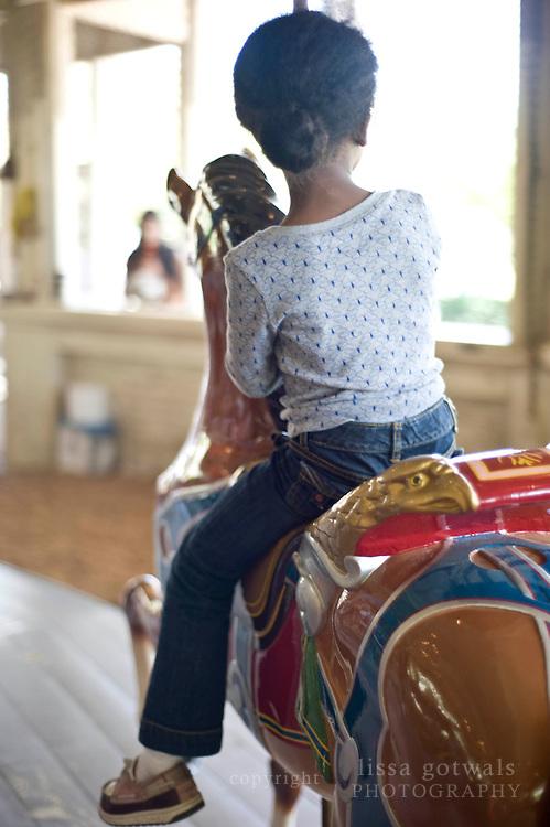 Ahbria Bradley on Pullen Park's Carousel.