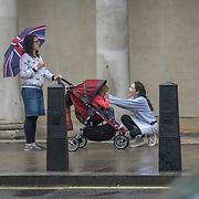 UK Weather:  Pedestrians holding a union jack umbrella in Rainy London, UK. 19 July 2019.