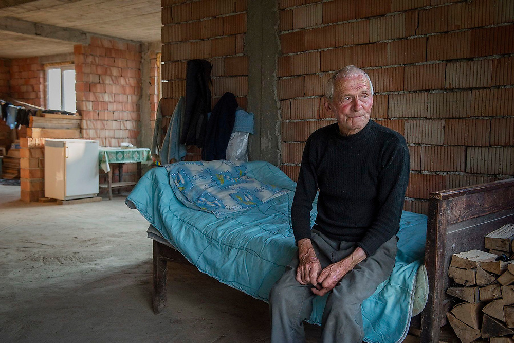 Ioan Gherman, 83, in his grandson's house. The grandson left to work in France and sent money home to finish the building work.