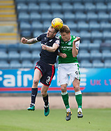 27th August 2017, Dens Park, Dundee, Dundee; Scottish Premier League football, Dundee versus Hibernian; Dundee's Kevin Holt and Hibernian's Vykintas Slivka compete in the air