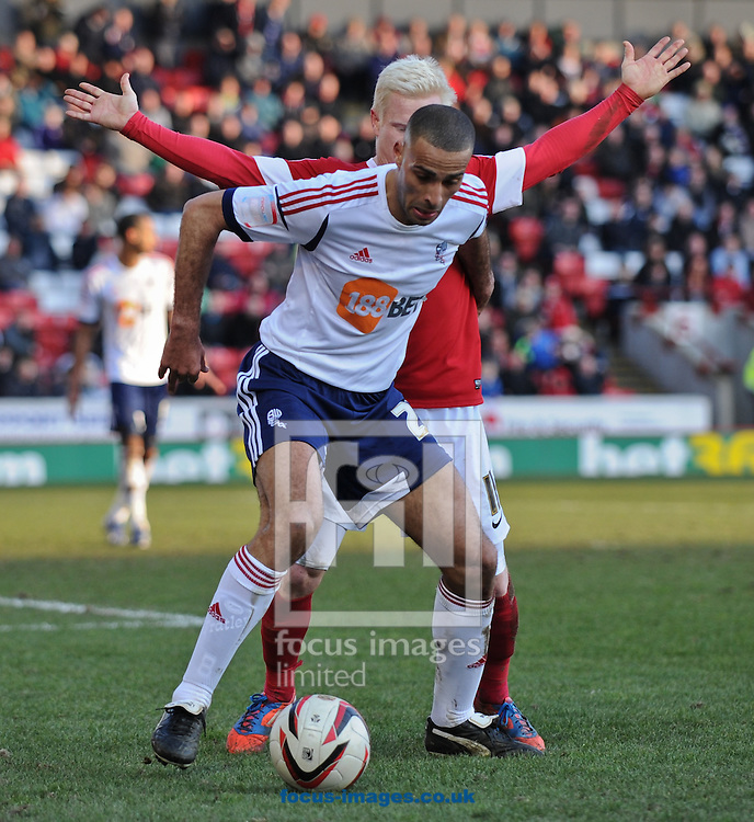 Picture by Richard Land/Focus Images Ltd +44 7713 507003.02/03/2013.David Perkins of Barnsley and Darren Pratley of Bolton Wanderers during the npower Championship match at Oakwell, Barnsley.