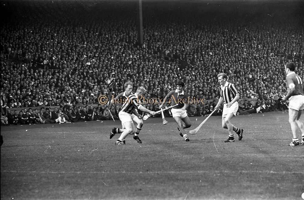 07/09/1969<br /> 09/07/1969<br /> 7 September 1969<br /> All-Ireland Senior Hurling Final: Kilkenny v Cork at Croke Park, Dublin.  <br /> Kilkenny full-back, Sean Treacy, with the ball and Kilkenny back, P. MacAindre, tries to get past Cork full-forward, C. MacCarthaigh (center of the picture), and Cork, full-forward, T.O. Riain.
