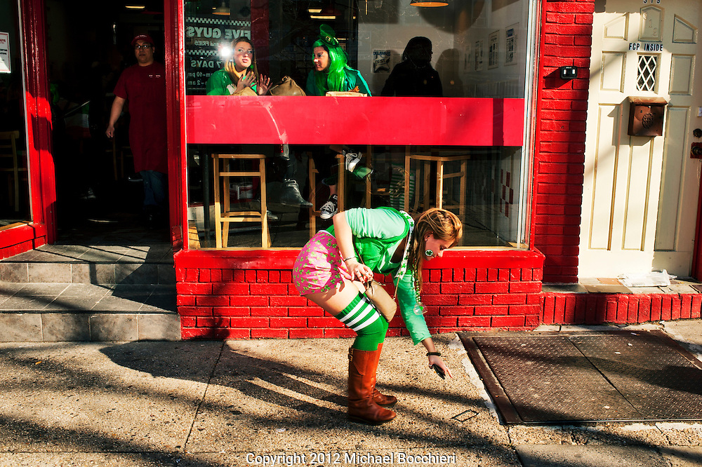 HOBOKEN, NJ - MARCH 03:  A girl picks up her phone during the Lepre-Con event as part of St. Patrick's Day festivities March 03, 2012 in Hoboken, New Jersey. Following the city's cancelation of the annual St. Patrick's Day Parade organizers held a city-wide drinking event that attracted thousands to the area.  (Photo by Michael Bocchieri/Bocchieri Archive)