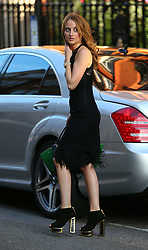 Made In Chelsea star Rosie Fortescue wearing a black lace dress, Celine handbag and a pair of Kate Maconie heels at Claridges Hotel in London, UK. 03/09/2014<br />