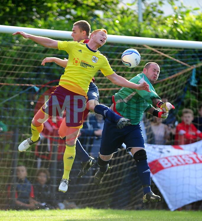 Bristol City's Ryan Taylor challenges for a header - Photo mandatory by-line: Dougie Allward/JMP - Tel: Mobile: 07966 386802 03/07/2013 - SPORT - FOOTBALL - Bristol -  Ashton and Backwell United V Bristol City - Pre Season Friendly