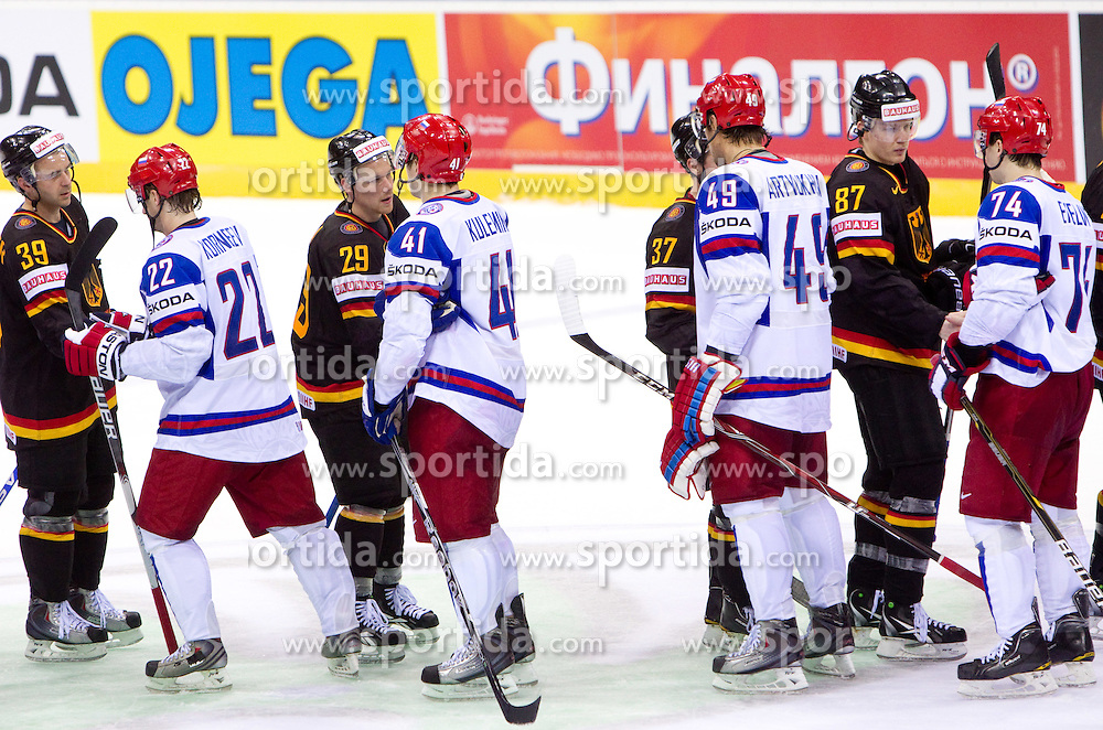 Thomas Greilinger of Germany, Konstantin Korneyev of Russia, Alexander Barta of Germany, Nikolai Kulyomin of Russia, Yevgeni Artyukhin of Russia, Philip Gogulla of Germany and Alexei Yemelin of Russia after the ice-hockey match between Germany and Russia of Group A of IIHF 2011 World Championship Slovakia, on April 29, 2011 in Orange Arena, Bratislava, Slovakia. Germany defeated Russia 2-0. (Photo By Vid Ponikvar / Sportida.com)