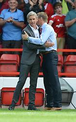BlackPool's Manger Jose Riga embraces Nottingham Forest's Manager Stuart Pearce - Photo mandatory by-line: Alex James/JMP - Mobile: 07966 386802 09/08/2014 - SPORT - FOOTBALL - Nottingham - City Ground - Nottingham Forest v Blackpool - Sky Bet Championship - First game of the season