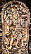 Guardian deity adorned with crown of seven flaring hooded cobras.<br /> (Photo by Matt Considine - Images of Asia Collection)