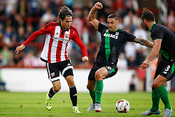 Jota of Brentford under pressure from Geoff Cameron of Stoke City - Mandatory by-line: Jason Brown/JMP - Mobile 07966 386802 25/07/2015 - SPORT - FOOTBALL - Brentford, Griffin Park - Brentford v Stoke City - Pre-Season Friendly