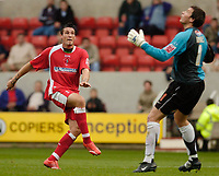 Photo: Leigh Quinnell.<br /> Swindon Town v Grimsby Town. Coca Cola League 2. 14/10/2006. Grimsbys goalkeeper Phillip Barnes can only look as Swindons Lee Peacock sends the ball over his head for a goal.
