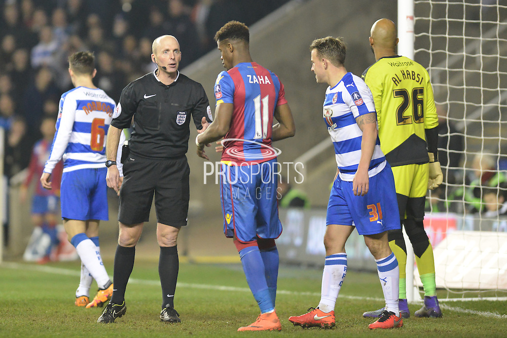 The ref talks to Crystal Palace midfielder Wilfried Zaha during the The FA Cup Quarter Final match between Reading and Crystal Palace at the Madejski Stadium, Reading, England on 11 March 2016. Photo by Mark Davies.