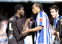 Photo: Olly Greenwood.<br />Colchester United v Brentford. Coca Cola League 1. 01/04/2006. Brentfords Sam Sodje has words with Colchester Chris Iwelumo