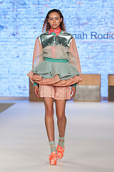 © Licensed to London News Pictures. 07/06/2016. London, UK. A model presents a look by Hannah Rodick from Manchester University.  Graduate Fashion Week, day three, takes place at the Old Truman Brewery in East London.  The event showcases the work of over 1,000 of the very best graduates from over 40 universities around the world through 22 catwalk shows and more.  Photo credit : Stephen Chung/LNP