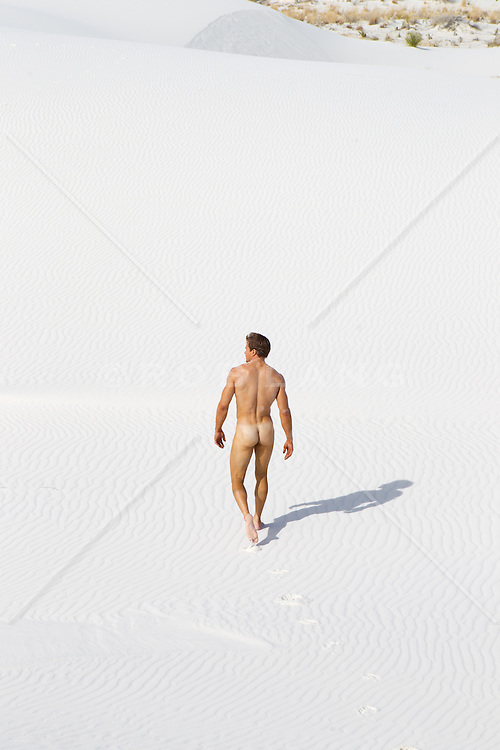 naked man walking on sand in White Sands, NM