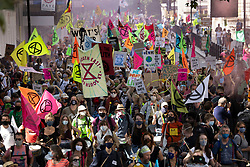 © Licensed to London News Pictures. 01/09/2020. London, UK. Extinction Rebellion (XR) environmental campaign protesters head to Parliament Square in central London. XR plan to peacefully disrupt the UK Parliament with actions planned over two weeks, until MP's back the Climate and Ecological Emergency Bill and prepare for crisis with a National Citizens' Assembly. Photo credit: Peter Macdiarmid/LNP