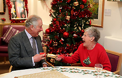 December 22, 2016 - Cheltenham, United Kingdom - Image icensed to i-Images Picture Agency. 22/12/2016. Cheltenham, United Kingdom. The Prince of Wales pulls a Christmas cracker with Barbara Stacey during a visit to the Sue Ryder Leckhampton Court Hospice in  Cheltenham , United Kingdom. Picture by ROTA / i-Images  UK OUT FOR 28 DAYS (Credit Image: © Rota/i-Images via ZUMA Wire)