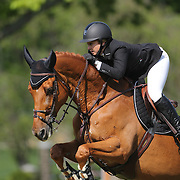 Kirsten Coe riding Baronez in action during the $100,000 Empire State Grand Prix presented by the Kincade Group during the Old Salem Farm Spring Horse Show, North Salem, New York,  USA. 17th May 2015. Photo Tim Clayton