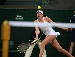 © Licensed to London News Pictures. 25/06/2014. LONDON, UK Wimbledon Tennis Championships 2014<br /> Day 3. Naomi Broady, GBR.  Photo credit : Mike King/LNP