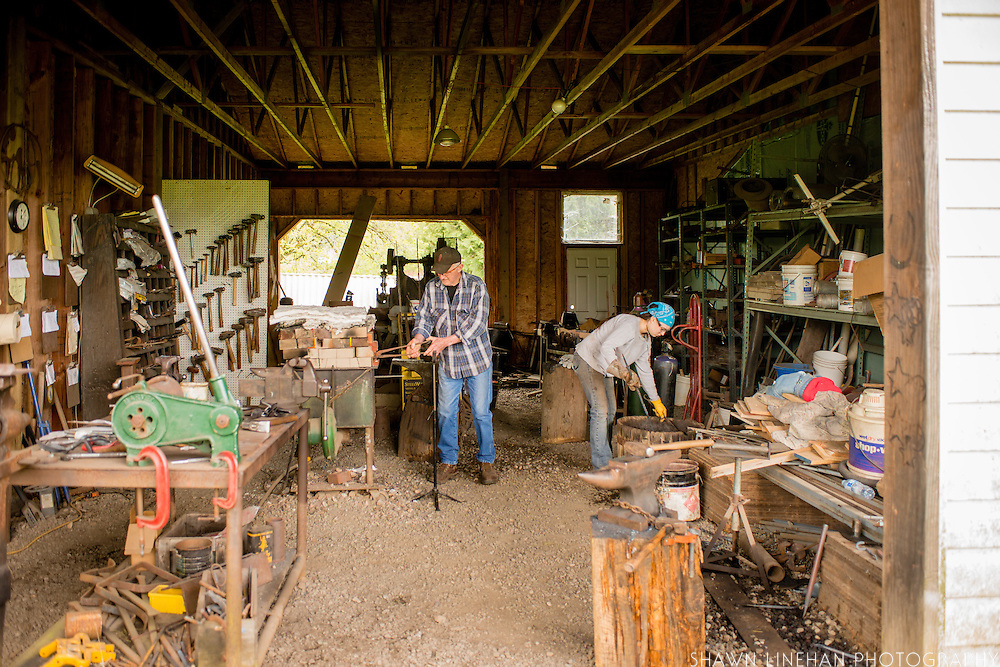 Bob Denman and his assistant in the forge at Red Pig Tools.