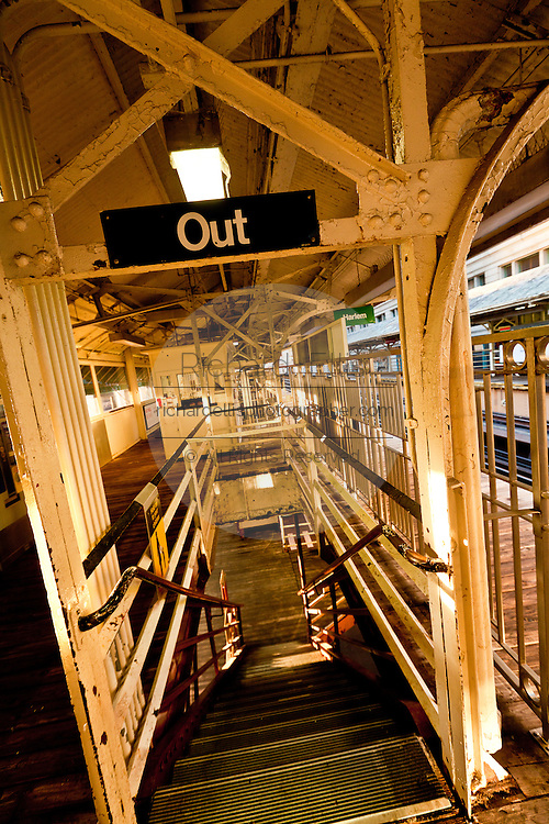 """Exit to the station transit lines on the stairs of the """"L"""", the elevated rapid transit system in Chicago, IL, USA."""