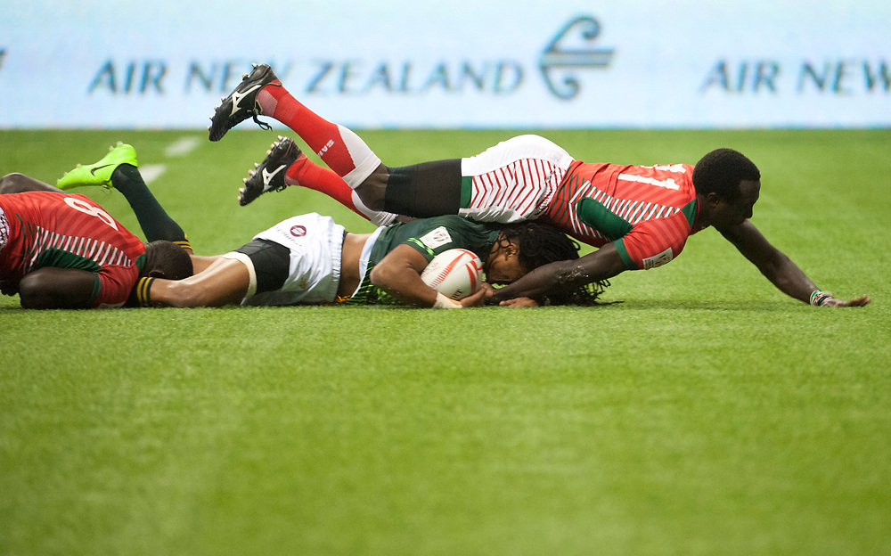 Rosko Specman of South Africa is tackled by Collins Injera of Kenya during the pool stages of the Canada Sevens,  Round Six of the World Rugby HSBC Sevens Series in Vancouver, British Columbia, Saturday March 11, 2017. <br /> <br /> Jack Megaw.<br /> <br /> www.jackmegaw.com<br /> <br /> jack@jackmegaw.com<br /> @jackmegawphoto<br /> [US] +1 610.764.3094<br /> [UK] +44 07481 764811