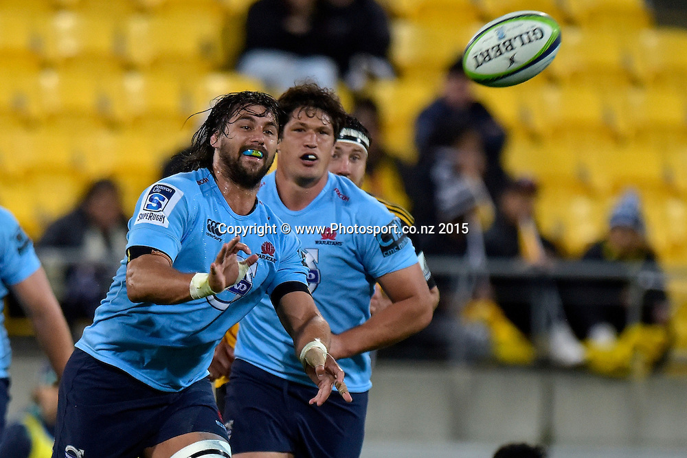 Waratahs' Mitchell Chapman makes a pass during the Super Rugby - Hurricanes v Waratahs rugby union match at the Westpac Stadium in Wellington on Saturday the 18th of April 2015. Photo by Marty Melville / www.Photosport.co.nz