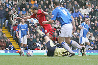 Photo: Mark Stephenson.<br /> Birmingham City v Cardiff City. Coca Cola Championship. 04/03/2007.Cardiff's Michael Chopra is brought down in the box by Birmingham's keeper Colin Doyle but the referee gives nothing