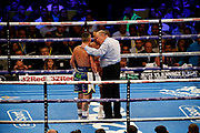 The referee gives a talking to Kid Galahad and Josh Warrington during the IBF World Featherweight Championship between Josh Warrington and Kid Galahad at First Direct Arena, Leeds, United Kingdom on 15 June 2019.