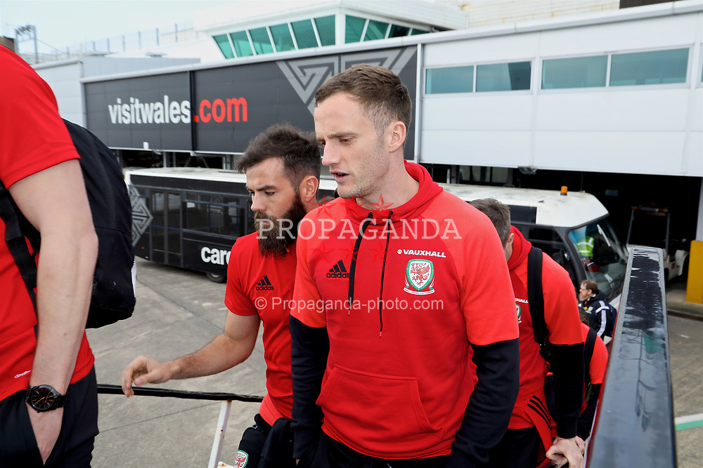CARDIFF, WALES - Thursday, March 23, 2017: Wales' Joe Ledley and Andy King board the team plane as the squad depart Cardiff Airport to fly to Dublin ahead of the 2018 FIFA World Cup Qualifying Group D match against Republic of Ireland. (Pic by David Rawcliffe/Propaganda)
