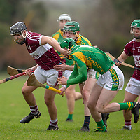 St Joseph's Doora-Barefield's Jarlath Colleran tries to get away from Broadford's Stiofan McMahon and Padraig Taylor