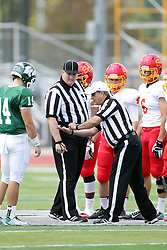 19 September 2015:   Coin toss with referee Dave Wallace, Umpire Jeff Conrad, Artie Checchin (14), Nate Connealy (4) and Sammy Sasso (6) during an NCAA division 3 football game between the Simpson College Storm and the Illinois Wesleyan Titans in Tucci Stadium on Wilder Field, Bloomington IL