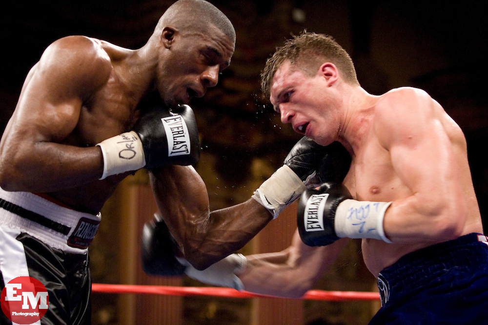 April 11, 2007; Bronx, NY, USA;  Andre Tsurkan (blue trunks) and Sammy Sparkman (black trunks) trade punches during their 10 round bout at the Paradise Theater.