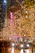 New York City. Radio City Music Hall seen through Christmas lights on West 51st Street during Christmas Season.