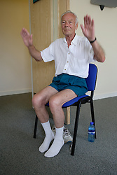 Older man taking part in keep fit class,