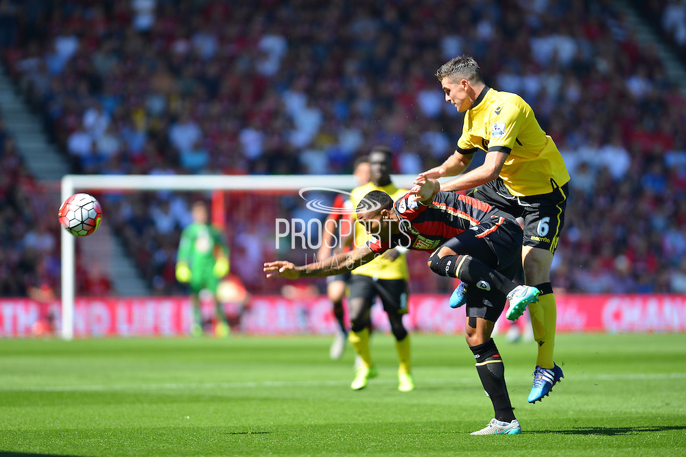 Aston Villa's Ciaran Clark and AFC Bournemouth's Callum Wilson during the Barclays Premier League match between Bournemouth and Aston Villa at the Goldsands Stadium, Bournemouth, England on 8 August 2015. Photo by Mark Davies.