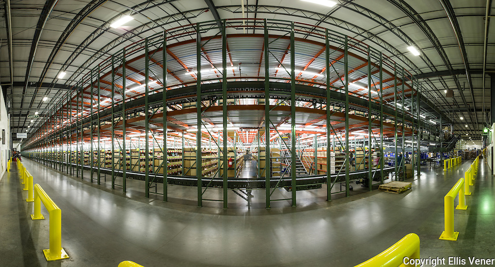 Panoramic interior of Chico's Distribution Center near IH-85Human workers interacting with  automated systems at distribution center warehouse.