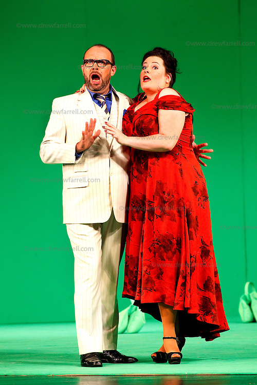 Picture shows : Karen Cargill as Isabella and  Adrian Powter as Taddeo..Picture  ©  Drew Farrell Tel : 07721 -735041..A new Scottish Opera production of  Rossini's 'The Italian Girl in Algiers' opens at The Theatre Royal Glasgow on Wednesday 21st October 2009..(Soap) opera as you've never seen it before.Tonight on Algiers.....Colin McColl's cheeky take on Rossini's comic opera is a riot of bunny girls, beach balls, and small screen heroes with big screen egos. Set in a TV studio during the filming of popular Latino soap, Algiers, the show pits Rossini's typically playful and lyrical music against the shoreline shenanigans of cast and crew. You'd think the scandal would be confined to the outrageous storylines, but there's as much action off set as there is on.... .Italian bass Tiziano Bracci makes his UK debut in the role of Mustafa. Scottish mezzo-soprano Karen Cargill, who the Guardian called a 'bright star' for her performance as Rosina in Scottish Opera's 2007 production of The Barber of Seville, sings Isabella. .Cast .Mustafa...Tiziano Bracci.Isabella..Karen Cargill.Lindoro...Thomas Walker.Elvira...Mary O'Sullivan.Zulma...Julia Riley.Haly...Paul Carey Jones.Taddeo...Adrian Powter. .Conductors.Wyn Davies.Derek Clarke (Nov 14). .Director by Colin McColl.Set and Lighting Designer by Tony Rabbit.Costume Designer by Nic Smillie..New co-production with New Zealand Opera.Production supported by.The Scottish Opera Syndicate.Sung in Italian with English supertitles..Performances.Theatre Royal, Glasgow - October 21, 25,29,31..Eden Court, Inverness - November 7. .His Majesty's Theatre, Aberdeen  - November 14..Festival Theatre,Edinburgh - November 21, 25, 27 ...Note to Editors:  This image is free to be used editorially in the promotion of Scottish Opera. Without prejudice ALL other licences without prior consent will be deemed a breach of copyright under the 1988. Copyright Design and Patents Act  and will be subject to payment or legal action, where appropriate..Further