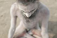 "Naga Sadhu, Kopal, covered in Human Ash which protects his body. ""I never feel the heat or the cold, the Holy Ash protects me"", Kopal said. Varanasi, India."