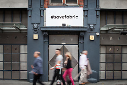 © Licensed to London News Pictures. 07/09/2016. London, UK. A '#SaveFabric' sign hangs outside London's world famous Fabric nightclub on Charterhouse Street. Islington Council revoked the club's license on 6 September 2016 following the drug-related deaths of two 18-year-old men. The decision has drawn condemnation from across the music community. Photo credit: Rob Pinney/LNP