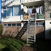 "Nederland Utrecht 31 januari 2009 20090131 Foto: David Rozing ..Serie vogelaarwijk Kanaleneiland .Nederland Utrecht 31 januari 2009 20090131 Foto: David Rozing ..Serie vogelaarwijk Kanaleneiland .Reportage documentary on deprived area / projects "" Kanaleneiland "" This area is on a list with projects which need help of the government because of degradation in the area etc.2 jongens voetballen in achtertuin tuin .2 boys playing in backyard., project, suburb, suburbian, problem. Neighboorhood, neighboorhoods, district, city, problems, multicultural, immigrant, immigrants, cultural diversity, daily life.satelietschotel,satelietschotels, antenne,satelliet,sateliet,satelietontvanger,satellietontvanger,schotels,antenneschotel,antenneschotels,schotelantenne,schotelantennes,tv,ontvangst,communicatie,electronica,tv ontvangst,televisie ontvangst,..Foto: David Rozing"