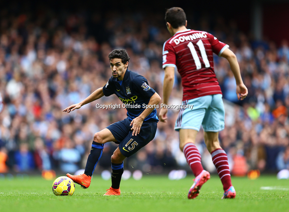 25 October 2014 - Barclays Premier League - West Ham v Manchester City - Jesus Navas of Manchester City in action with Stewart Downing of West Ham - Photo: Marc Atkins / Offside.