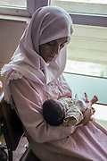 IRAQ, BAGHDAD:<br /> MOTHER WITH NEW BABY, SADDAM HUSSEIN<br /> TEACHING HOSPITAL