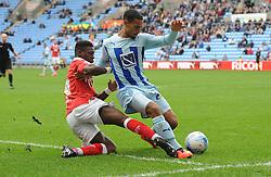 Bristol City's Kieran Agard tackles Coventry City's Jordan Clarke  - Photo mandatory by-line: Joe Meredith/JMP - Mobile: 07966 386802 - 18/10/2014 - SPORT - Football - Coventry - Ricoh Arena - Bristol City v Coventry City - Sky Bet League One