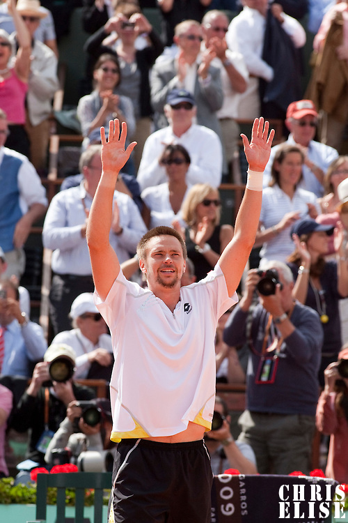 5 June 2009: Robin Soderling of Sweden falls celebrates victory during the Men's Singles Semi Final match on day thirteen of the French Open at Roland Garros in Paris, France.