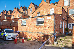 © Licensed to London News Pictures. 02/10/2017. BANBURY, UK.  General view of the entrance at the rear of a property in Newland Road, Banbury where Thames Valley Police are investigating a double murder. They where called at 6:45pm Sunday (1/10) evening and found the bodies of two men inside a downstairs flat. A 53 year old man has been arrested.   Photo credit: Cliff Hide/LNP