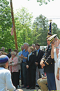 Chappaqua, NY, May 28: Bill and Hillary Clinton during Memorial Day ceremonies in their hometown of Chappaqua, New York.  Hillary Rodham Clinton was a United States Senator at the time (2006) and was Grand Marshall of the parade.