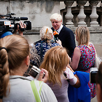 London, UK - 13 August 2012: tourists take pictures to Mayor Boris Johnson after the final press conference of the Olympic Games to discuss the success of London 2012.