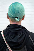 back view of woman with blue green hair