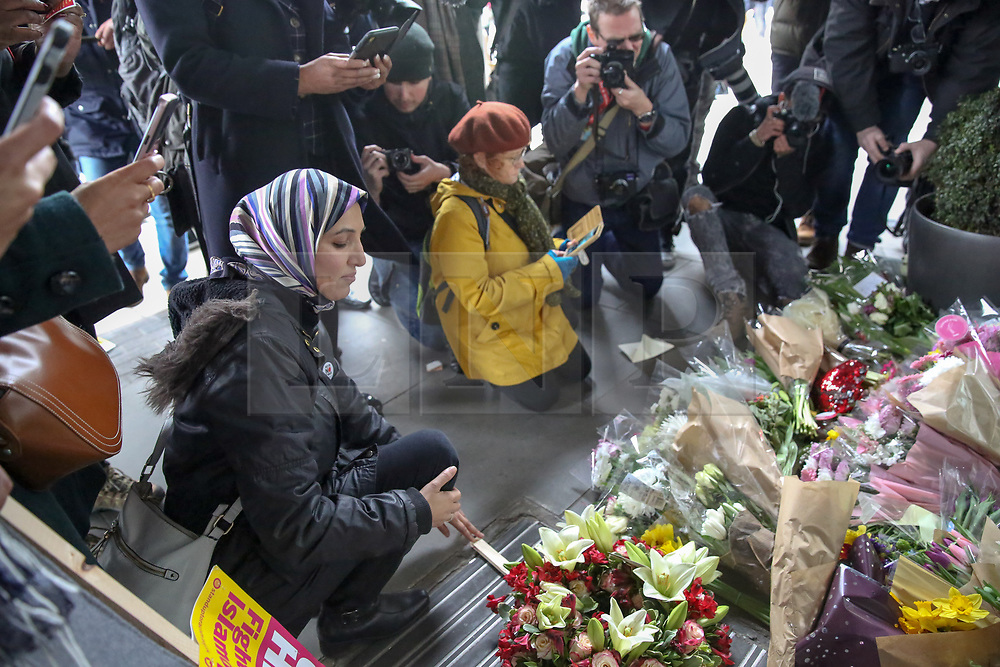 © Licensed to London News Pictures. 16/03/2019. London, UK. Representatives from Muslim Council of Britain lay flowers at High Commission of New Zealand in London. A gunman killed 49 worshippers at the Al Noor Masjid and Linwood Masjid mosques in Christchurch, New Zealand on 15 March. The 28-year-old Australian suspect, Brenton Tarrant, appeared in court on 16 March and was charged with murder. Photo credit: Dinendra Haria/LNP