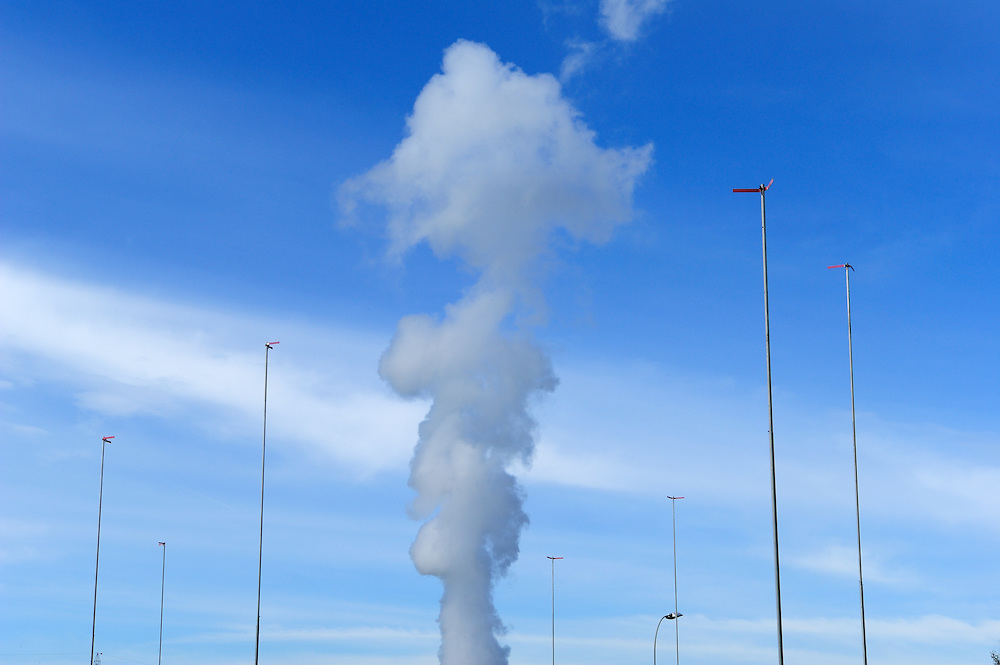 Vapour rising from the cooling tower of Gösgen Nuclear Power Plant (Kernkraftwerk Gösgen), with gaberits, which show the shape of a future construction. Nucleur power, from four plants, provides 40% of the country's electricity needs.